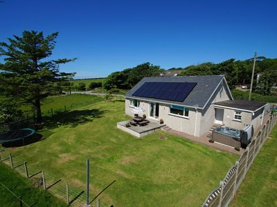 Photo for A tranquil, stylish, and spacious cottage in the peaceful countryside of North Wales, this is the fi