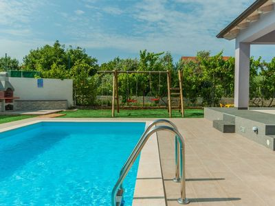 Photo for Lovely apartment for 9 guests with WIFI, private pool, A/C, TV and parking