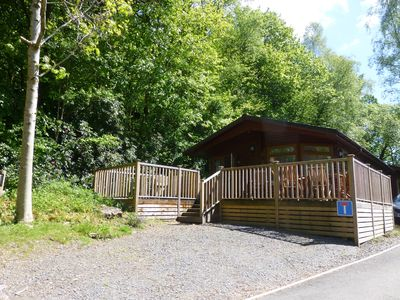 Photo for Luxury lodge set in 60 acres of wooded parkland with fell views and lake access