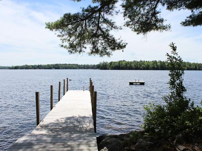 Lakefront cottage with large wraparound porch, family getaway with lake views