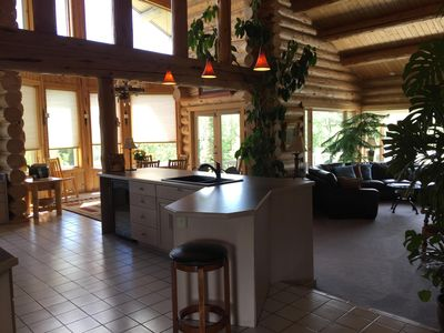 open kitchen, dining and living concept, vaulted ceilings