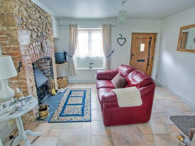 Photo for Devon cottage, 10 minute walk to beach through NT meadows.