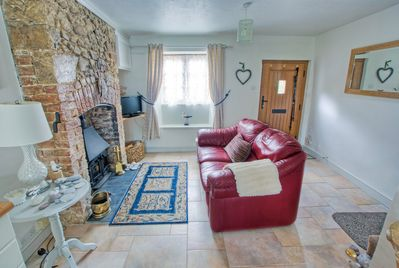 The Cottage, lounge with wood burner.