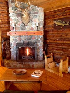 The stone fireplace at Wind Song creates a warm cozy atmosphere for you to enjoy