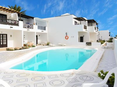 Photo for Homerez last minute deal - Nice apt with pool access and Wifi