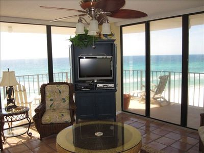 Living room with flat screen tv, great gulf view and floor to ceiling windows.