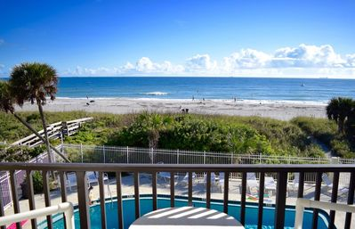 Photo for Beautiful views from your bed and balcony, on the beach and steps to the pier!
