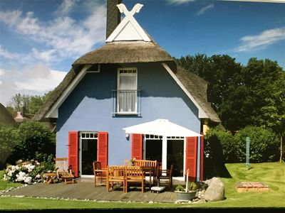 Photo for Stylish thatched roof house with lots of sun, luxury, great garden & lighthouse view