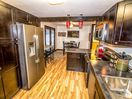 Big fully-stocked kitchen with stainless appliances