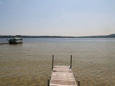 Photo for Up North Style Log Cottage With Private Lake Leelanau Waterfront-Book for Summer 2019