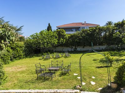 Photo for Charming home w/ garden, terrace & fruit trees - less than a mile to beaches!