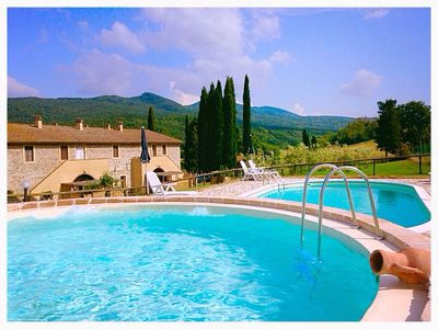 Photo for Two bedroom apartment on the ground floor in a farmhouse with swimming pool near Pisa
