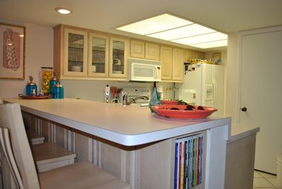 Plenty of counter space, seating and amenities in the kitchen area.
