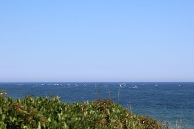 Ocean view from skybox deck with fishing boats.