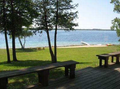 Enjoy an expansive view of Suttons Bay and West Grand Traverse Bay.