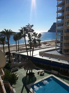 Photo for Apartment feet in the water, stunning sea and mountain views