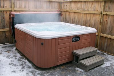 7 Person Hot tub which is 15 feet from the door