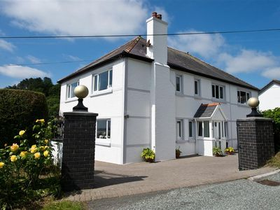 Photo for Set in an acre of beautiful grounds in the coastal village of Amroth, Sunnyridge is a spacious prope