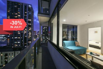 A large balcony with a view of the city.