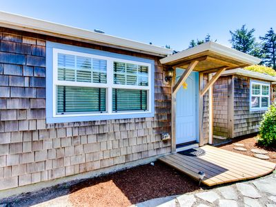 Photo for Six dog-friendly cottages w/ shared courtyard & grill - 2 blocks to beach!