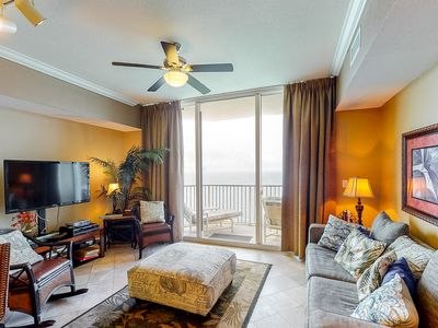 Photo for Tropical, Gulf front condo w/ a private balcony, shared pool, & hot tub!