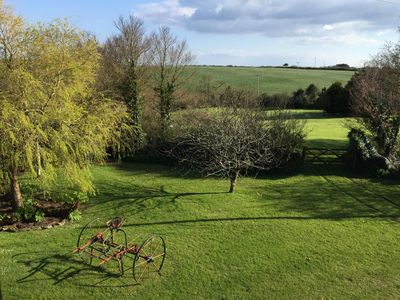View of garden and fields from double bedroom.