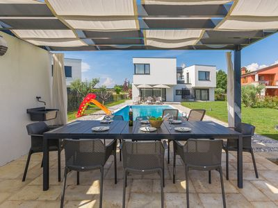 Photo for This 4-bedroom villa for up to 8 guests is located in Novigrad and has a private swimming pool, air-