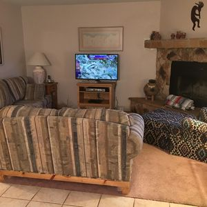 Comfortable seating, sofa, loveseat & easy chair. New large flatscreens.