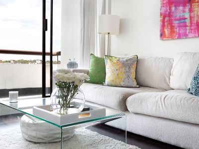 Photo for ELLE APARTMENT - Relax in the crisp luxury of this modern yet comfortable apartment. Its bright, north aspect provides a natural botanic atmosphere and a feeling of peace, despite the central location. Unwind on the private balcony after a day at the beach.