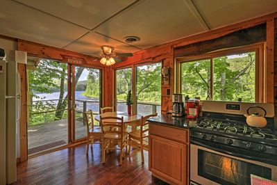Inside, the home boasts 2 bedrooms, 1 bathroom and window-framed river views.