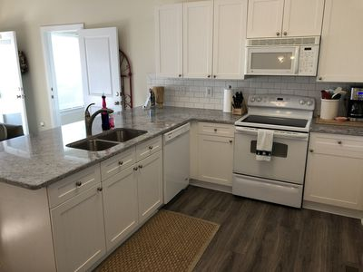 Kitchen with new granite counter top and laminate floor
