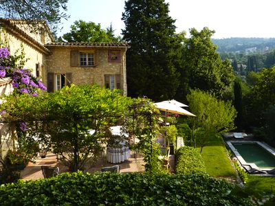 Photo for Beautiful 200 year old stone farmhouse with heated pool and sunny terraces