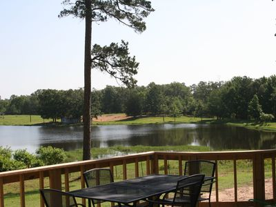 Photo for Secluded log cabin On Private Fishing Lake, near Beavers Bend, Broken Bow Lake