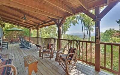Photo for Panoramic mountain views from this privately located rustic log home.