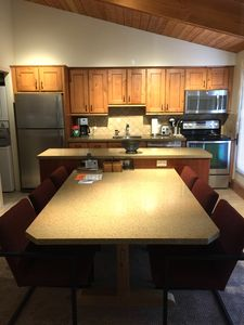 Brand new stainless steel kitchen, new dining room furniture