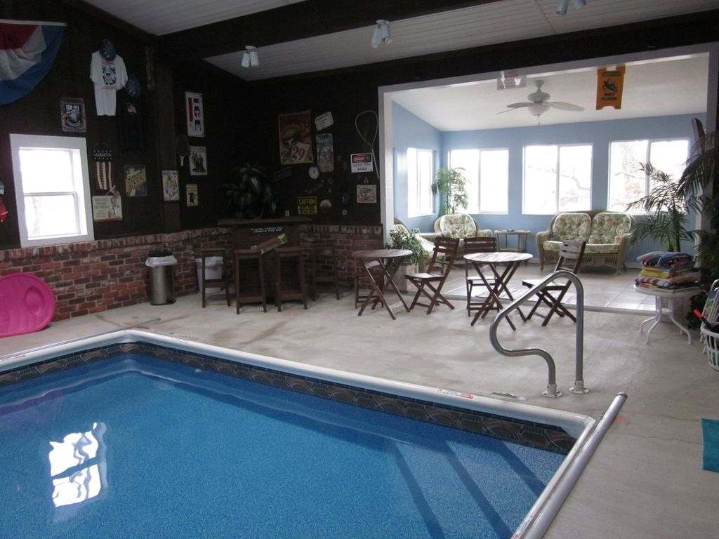 Home indoor pool with bar  Spacious 5,000 Sq. Ft. Home with Indoor Poo... - VRBO