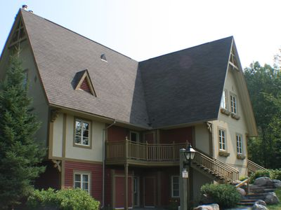 Photo for Mont Tremblant resort SKI IN/OUT 4 bed sleep 8 family friendly with LARGE POOL