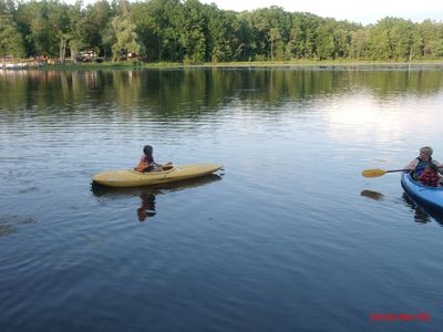 "Guests enjoying kayaking on the lake in front of our ""tr-ottage""."