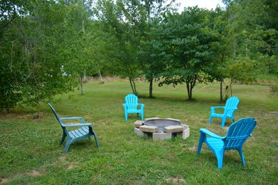 Fire Pit With Four Chairs.  There is also a Picnic Table and Gas Grill.
