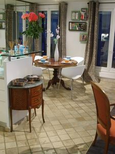 Kitchen and dining areas offer lots of space for couples and families