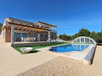 Photo for Villa with private swimming pool situated in quiet area with coastal views!