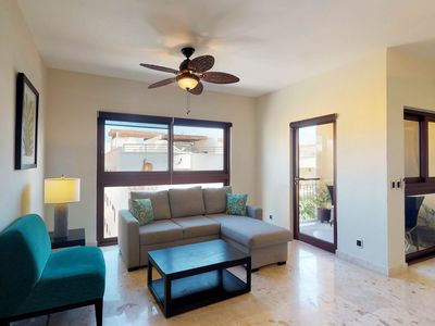 Photo for Beautiful condo in beachfront resort with shared infinity pool, security, gym