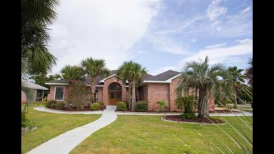 One level home with pool min from the beach in Perdido area. Handicap Accessible