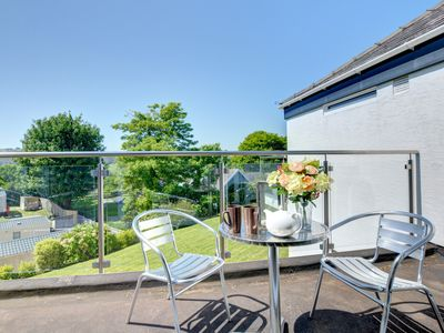 Photo for Happy Days is a bright first floor self – catering apartment less than half a mile from the beach