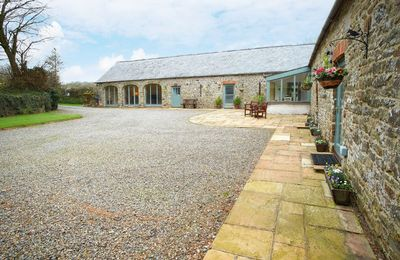 Photo for A Grade II listed, detached, stone barn situated in the heart of the Pembrokeshire countryside.