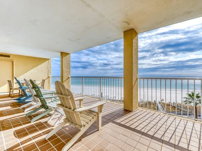 Photo for Upscale, beachfront condo w/ a private balcony, shared pools, & beach access