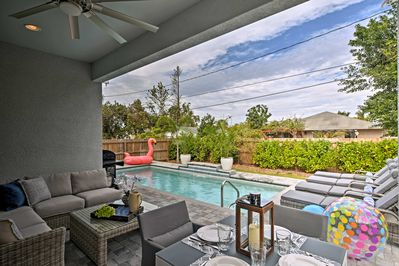Lounge by the heated saltwater pool at this Naples vacation rental house!