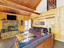 "Living Area - Curl up in front of a wood-burning fireplace and 42"" flat screen TV with DVD player in the Great Room."