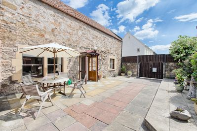 Private walled courtyard - an ideal spot to sit and enjoy the sunshine.
