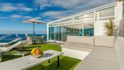 Photo for NEW LUXURY VILLA WITH CLIMATIZED SWIMMING POOL OVER THE CLIFF, AMAZING SUNSETS